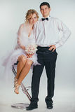 Couple of bride and groom covered with veil Royalty Free Stock Images