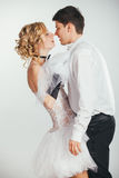 Couple of bride and groom covered with veil Royalty Free Stock Photo
