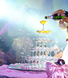 Couple bride groom pour champagne. Just married couple pouring sparkling bubbly champagne into glasses. Selective focus Royalty Free Stock Photo