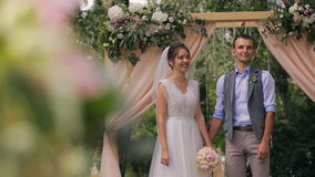 Couple of bride and groom during wedding outdoor registration in forest stock video footage