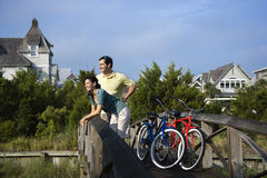 Couple on Bridge with Bicycles Stock Photo
