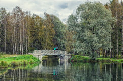 A couple on the bridge on the Silver lake in Gatchina. stock image