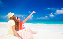 Couple in bright clothes having fun at tropical Royalty Free Stock Images