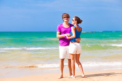 Couple in bright clothes standing on tropical Royalty Free Stock Photography