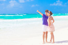 Couple in bright clothes on tropical beach in Royalty Free Stock Photo
