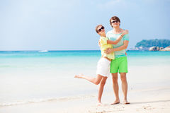 Couple in bright clothes on tropical beach in Stock Image