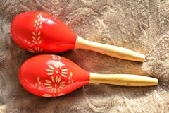 Couple of bright red wooden maracas Stock Image
