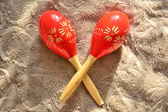 Couple of bright red wooden maracas Royalty Free Stock Images