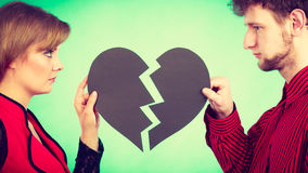 Couple with broken heart breaking up. Stock Images