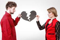 Couple with broken heart breaking up. Royalty Free Stock Photography