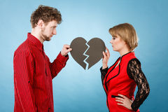 Couple with broken heart breaking up. Royalty Free Stock Images