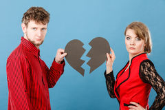 Couple with broken heart breaking up. Royalty Free Stock Photos