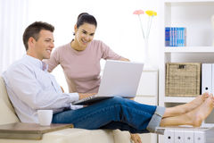 Couple Browsing Internet Stock Photo