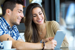 Couple browsing internet with digital tablet Stock Photos