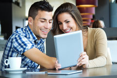 Couple browsing internet with digital tablet Royalty Free Stock Photography