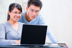 Couple browsing internet at home Stock Photography