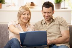 Couple browsing internet on laptop royalty free stock photo