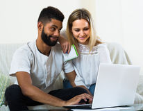 Couple browsing web at home Royalty Free Stock Image