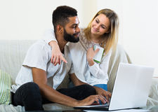 Couple browsing web at home Stock Image