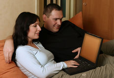 Couple Browsing WWW 3. Couple browsing www with laptop at home Stock Image