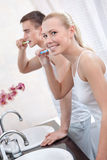 Couple brushes teeth Stock Photo