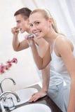 Couple brushes teeth Stock Photo