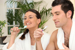 Couple brushing teeth royalty free stock images