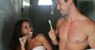 Couple Brushing Teeth In Bathroom Dancing, Cheerful Man And Woman Happy Smiling Doing Morning Hygiene. Point Of View Slow Motion 60 stock video footage