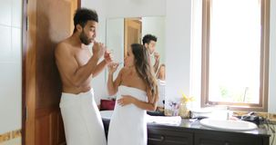 Couple Brushing Teeth In Bathroom, Dancing Cheerful Man And Woman Happy Smiling Doing Morning Hygiene. Routine stock footage