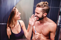 Couple brushing teeth and having fun Stock Photography