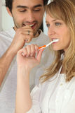 Couple brushing their teeth Stock Image
