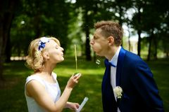 Couple with bubble on their wedding Stock Photography