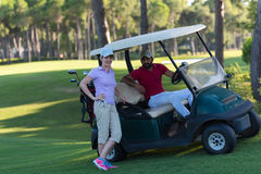 Couple in buggy on golf course Royalty Free Stock Image