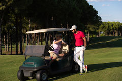 Couple in buggy on golf course Royalty Free Stock Photography