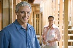 Couple Building Home Stock Photo