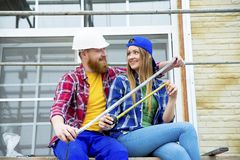 Couple building a house. Construction. Man and his wife building a house Stock Photography