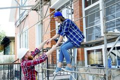 Couple building a house. Construction. Man and his wife building a house Royalty Free Stock Photography