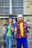 Couple building a house. Construction. Man and his wife building a house Royalty Free Stock Image