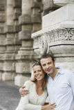 Couple By Building Pillars In Rome Stock Photo