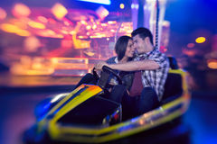 Couple in bumper car Royalty Free Stock Photos