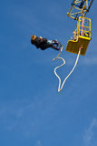 Couple Bungee jumping. Bungee jumping, Couple jumps into the north sea attached with the elastic, scheveningen, Netherlands Royalty Free Stock Photo