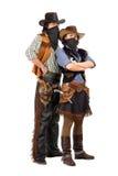Couple of burglars in cowboy costumes stock photos