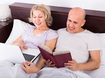 Couple burring with laptop Stock Image