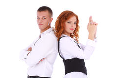 Couple in business dresses showing gun. Young couple in business dresses showing gun with hands on white background Stock Image