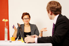 Couple in business meeting Royalty Free Stock Photos