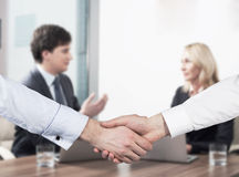 Couple at the business meeting. Handshake as a concept of successful deal. Stock Photo