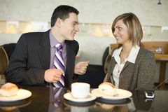 Couple of Business People at Coffee Break royalty free stock images