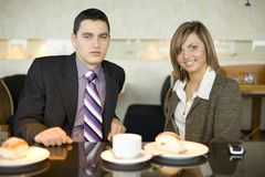 Couple of Business People at Coffee Break Royalty Free Stock Image