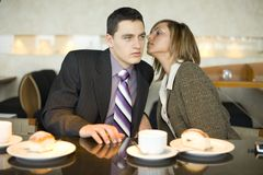 Couple of Business People at Coffee Break - Whispering Stock Images