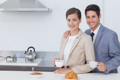 Couple of business people having breakfast Stock Photos
